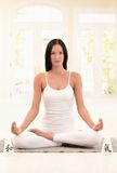 Attractive woman practicing yoga Stock Photography