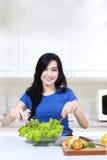 Attractive woman prepare vegetable salad Royalty Free Stock Photo