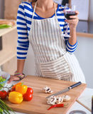 Attractive woman preparing food in the kitchen Royalty Free Stock Images