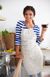 Attractive woman preparing food in the kitchen Royalty Free Stock Photos