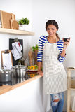 Attractive woman preparing food in the kitchen Royalty Free Stock Photo