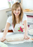 Attractive woman preparing a meal in the kitchen Royalty Free Stock Images