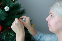 Attractive woman preparing the tree for Christmas Stock Photo