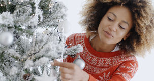 Attractive woman preparing the tree for Christmas Stock Image
