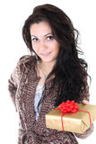 Attractive woman with present over white Royalty Free Stock Photos