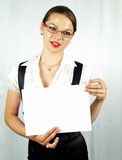 Attractive woman presenting. Customizable white sheet of paper Stock Photo