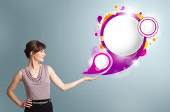 Attractive woman presenting abstract speech bubble copy space Royalty Free Stock Photography