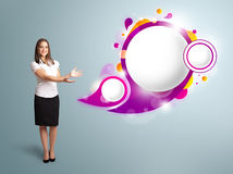 Attractive woman presenting abstract speech bubble copy space. Attractive young woman presenting abstract speech bubble copy space Royalty Free Stock Image