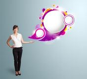 Attractive woman presenting abstract speech bubble copy space. Attractive young woman presenting abstract speech bubble copy space Stock Images