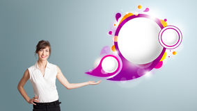 Attractive woman presenting abstract speech bubble copy space. Attractive young woman presenting abstract speech bubble copy space Royalty Free Stock Photos