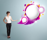 Attractive woman presenting abstract speech bubble copy space. Attractive young woman presenting abstract speech bubble copy space Royalty Free Stock Photography