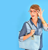Attractive woman presenting new accessories collection Stock Photos