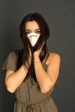 Attractive woman with protective mask Stock Photography