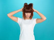 Attractive woman pulling her hair Royalty Free Stock Photography
