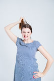Attractive woman pulling her hair Stock Photo