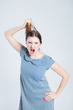 Attractive woman pulling her hair Stock Photos