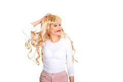 Attractive woman pulls his wig out. Royalty Free Stock Photo