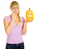Attractive woman with a pumpkin for Halloween Royalty Free Stock Photos