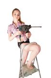 Attractive woman with puncher on ladder Royalty Free Stock Photography
