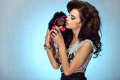 Attractive woman with puppy. Stock Images