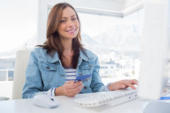 Attractive woman purchasing online with her credit card Royalty Free Stock Photos