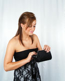 Attractive woman with purse. Attractive woman looking into purse Royalty Free Stock Photo
