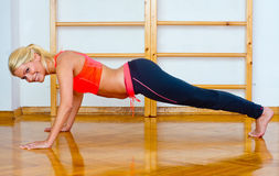 Attractive woman in push up position Stock Photography