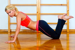 Attractive woman in push up position Royalty Free Stock Images