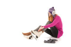 Attractive woman put on the ice skates Stock Images