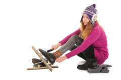 Attractive woman put on the ice skates Stock Photography