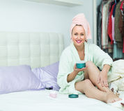Attractive woman putting cream on legs Royalty Free Stock Photo