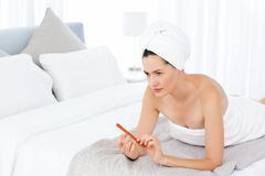 Attractive woman putting on Make up Royalty Free Stock Image