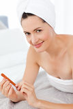 Attractive woman putting on Make up Stock Photography