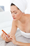 Attractive woman putting on Make up Stock Image