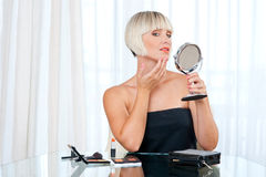 Attractive woman putting make up Royalty Free Stock Photo