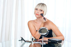 Attractive woman putting make up Stock Photo