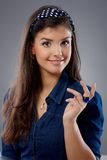 Attractive woman with questioning look Royalty Free Stock Image