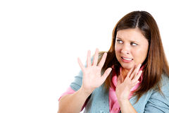 Attractive woman raising hands up in defense, scared and about to be attacked Stock Images