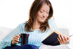 Attractive Woman Reading A Book Stock Photos