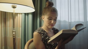 Attractive  woman reading a book at home. stock video
