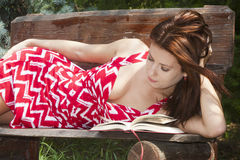 Attractive woman reading book in the park Stock Image