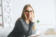 Attractive woman reading book Royalty Free Stock Photography