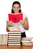 Attractive woman reading in a library Stock Photos
