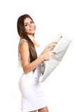 Attractive woman reading a newspaper on a white background Stock Photo