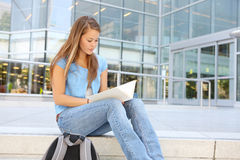 Attractive Woman Reading at School Library Royalty Free Stock Photo