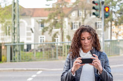 Attractive woman reading a text message Royalty Free Stock Photo