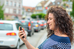 Attractive woman reading a text message Stock Images