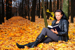 The attractive woman reads the book Stock Photos