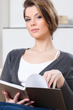 Attractive woman reads the book Stock Photos
