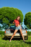 Attractive woman ready for washing a car Stock Image